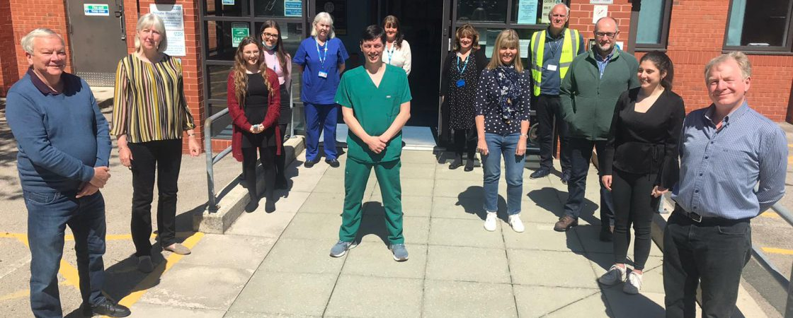 Dr Darran Harris, clinical lead for Hants Lane Clinic, with volunteers